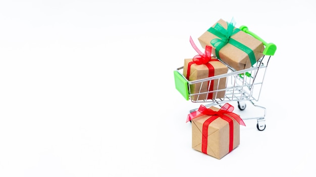 Small cart or trolley with gift boxes, copy space