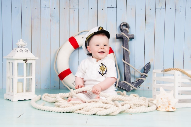 A small cheerful captain in a maritime interior