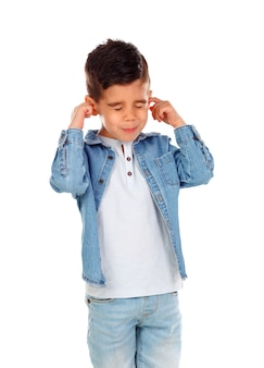 Small child covering his ears