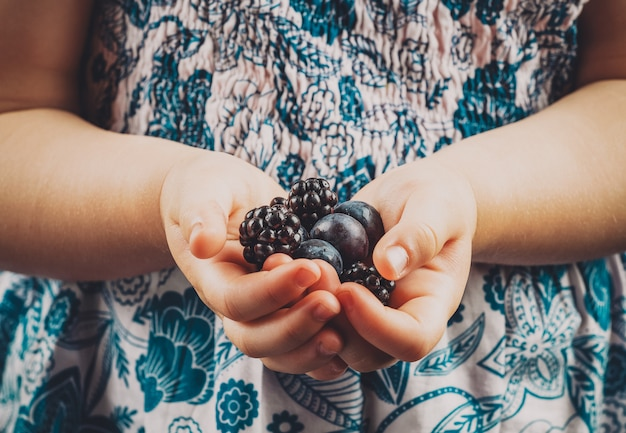 Small child hands holding berries