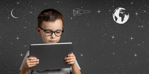Small child plays a virtual game dreaming of being an astronaut