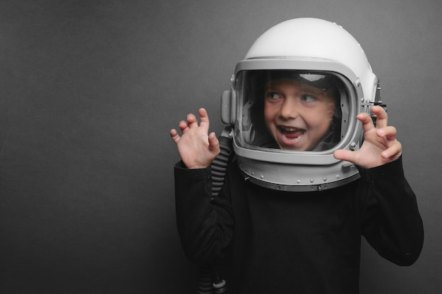 Small child wearing astronaut helmet