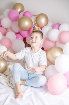 Small child with party balloons, celebration.