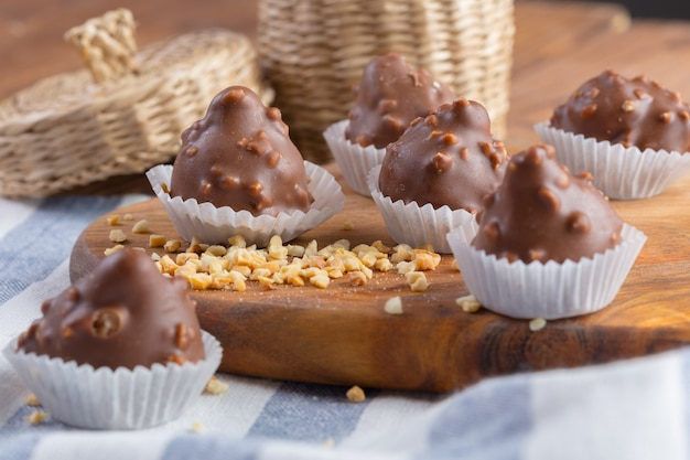 Small chocolate sweets with nuts close up