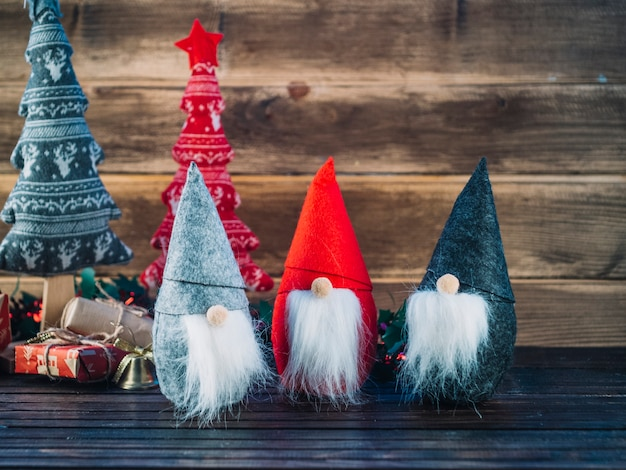 Small christmas elves on wooden table