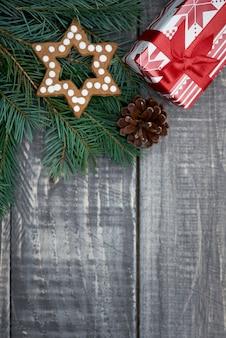 Small christmas present on the wood
