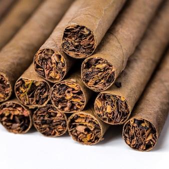 The small cigarillos  on white Premium Photo