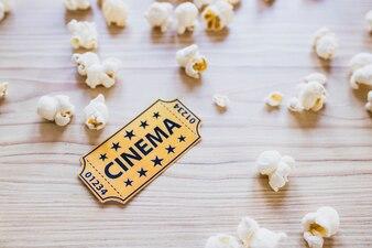 Small cinema ticket with popcorn
