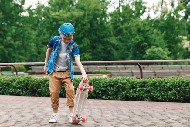 A small city boy andskateboard. a young guy is riding in a parka skateboard