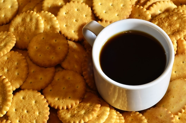 Small coffee cup and salted cracker