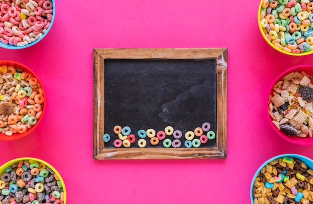 Small colourful cereals on chalkboard