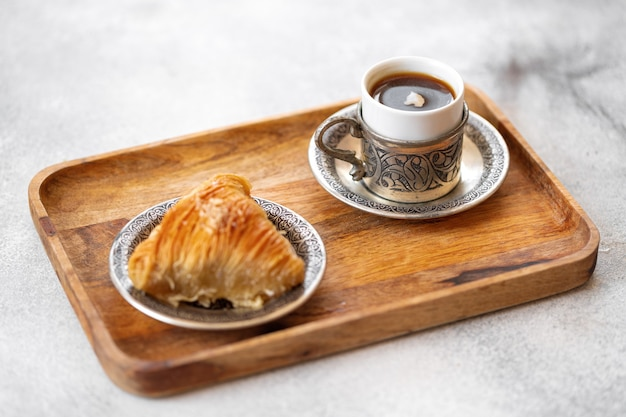 Small cup of turkish coffee and turkish baklava