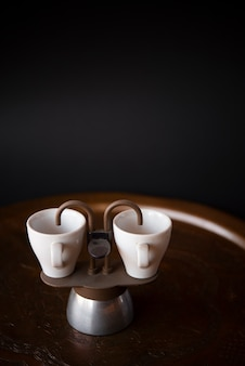 Small cups of espresso with copy space background