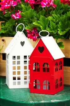Small cute garden houses with heart shape windows in garden with