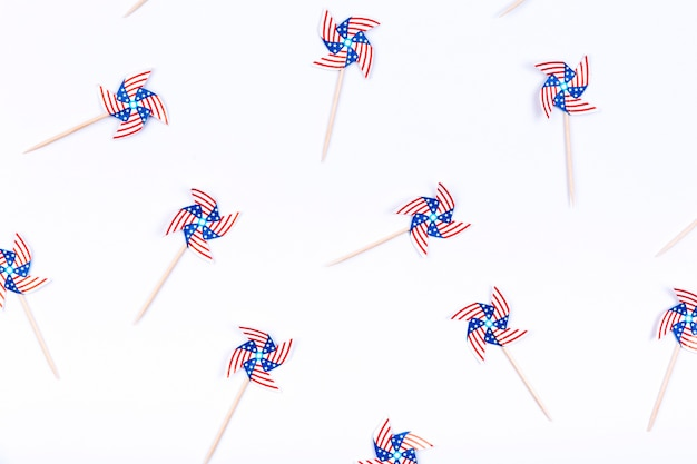 Small decorated with usa flag pinwheels on white background