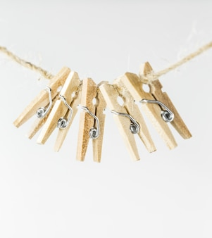 Small decorative clothespins on a white background
