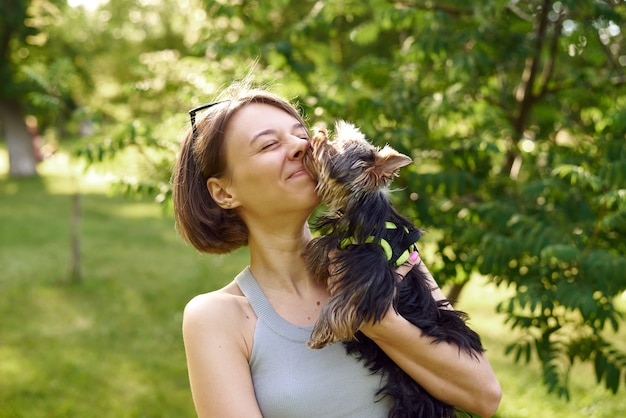 A small dog licks its master. walking with your pet