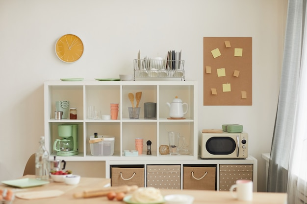 Small domestic kitchen with shelves and boxes