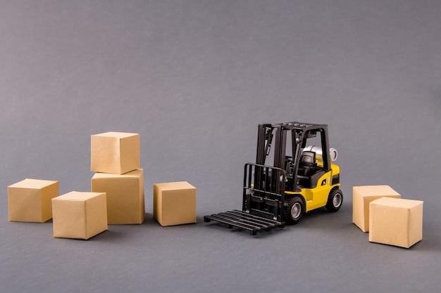Small electric vehicle loader bringing delivering stuff