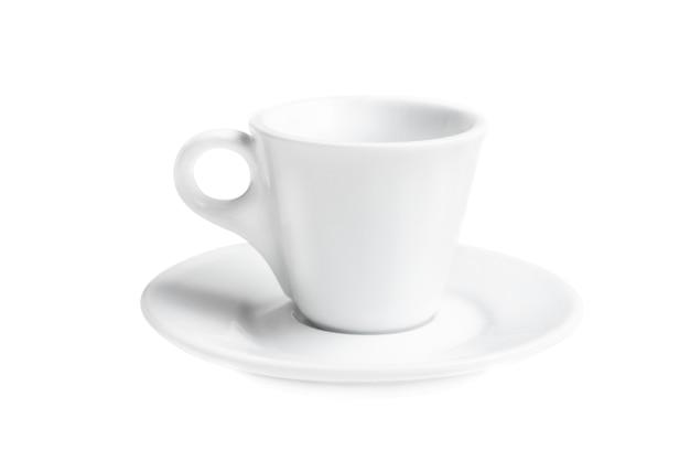 孤立した小さな空の白いコーヒーカップ
