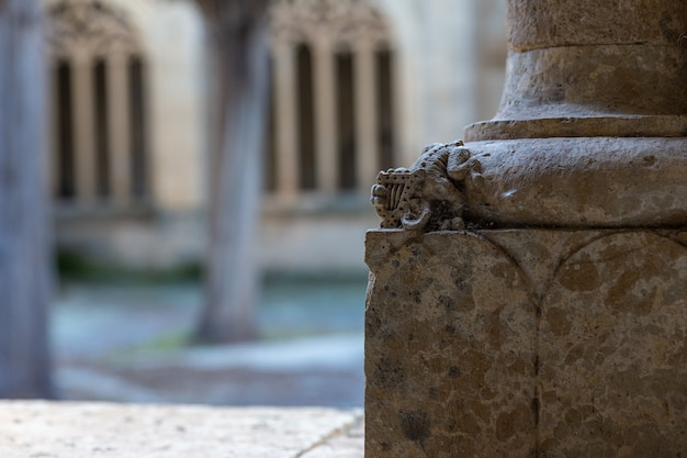 Small figure on the basis of a column of the cloister at the cathedral of ciudad rodrigo spain