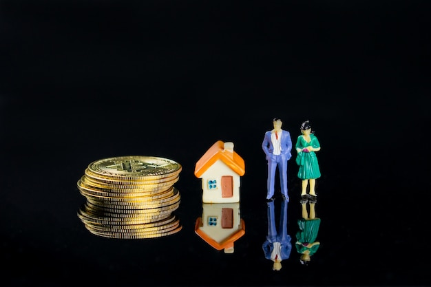 Small figure models show more people want to have money, home and good family.