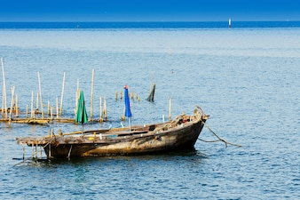 Small fishing boats in the sea.