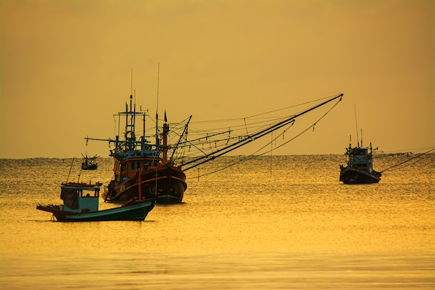 Small fishing boats in  the sea sea in twilight time