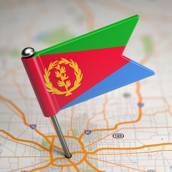 Small flag state of  eritrea on a map background with selective focus.