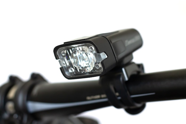 Small flashlight for bicycle handlebar isolated