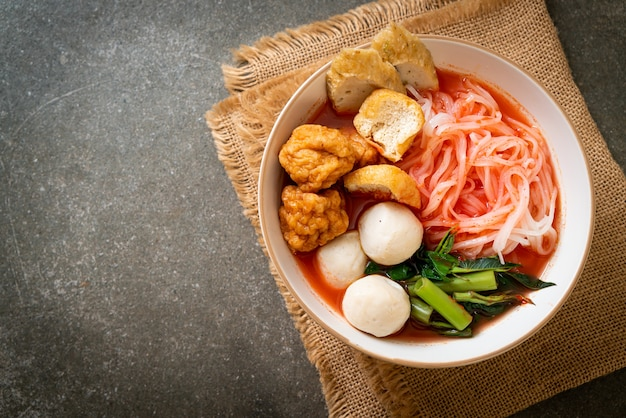 Small flat rice noodles with fish balls and shrimp balls in pink soup, yen ta four or yen ta fo. asian food style