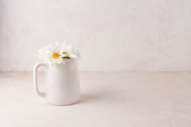 Small flowers in porcelain jar