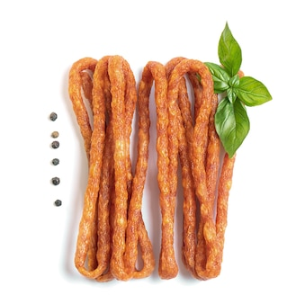 Small fragrant sausages to beer on white