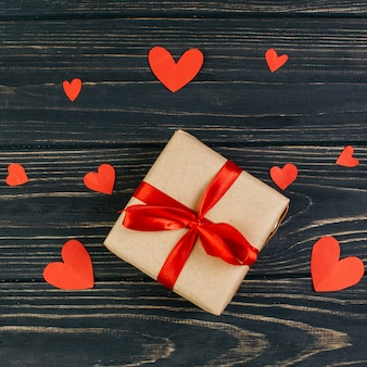 Small gift box with paper hearts