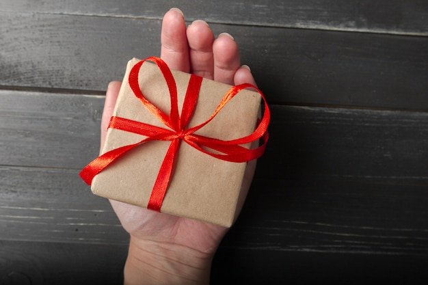 Small gift box with red ribbon close up