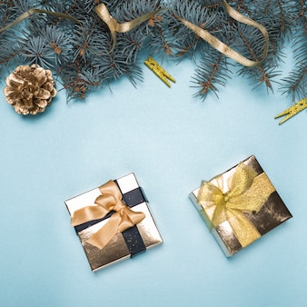 Small gift boxes with fir tree branches on table