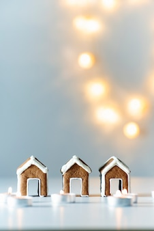 Small gingerbread houses, candles and christmas lights