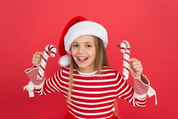 Small girl having fun santa elf kid candy cane decor xmas holiday decoration christmas shopping