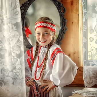A small girl in a traditional russian costume