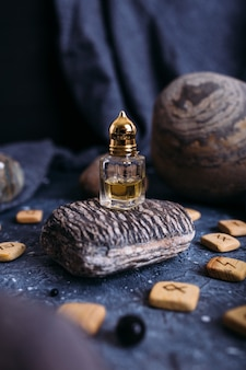 Small glass bottle with natural magic oil cosmetic and magic elixir