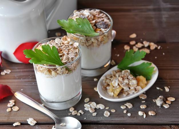 Small glasses of plain yogurt with muesli and raisins