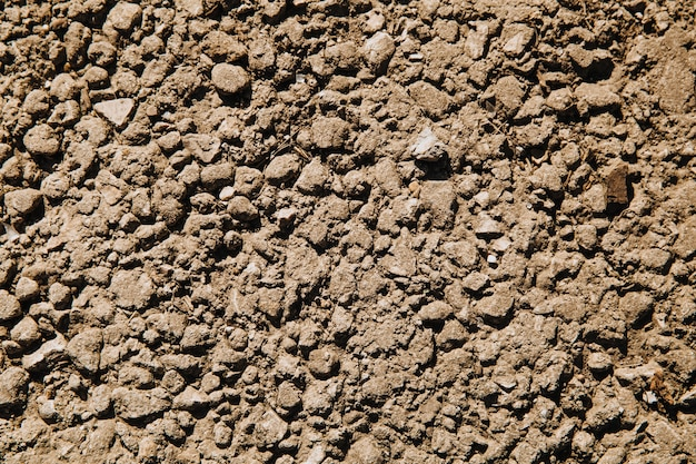 Small gray crushed stone crushed in the mud.