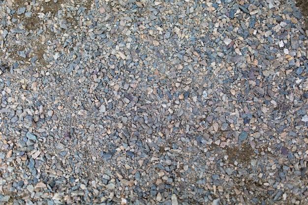 Небольшой серый гравий на дороге текстуры