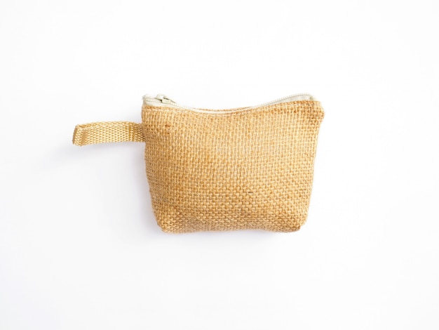 Small handicraft purse for coin made of natural fabric