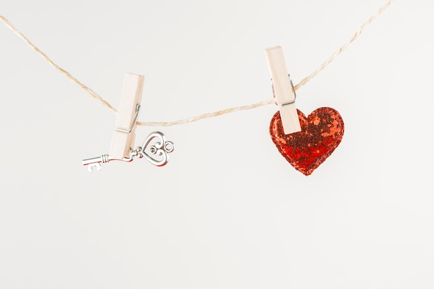 Small heart with key hanging on rope