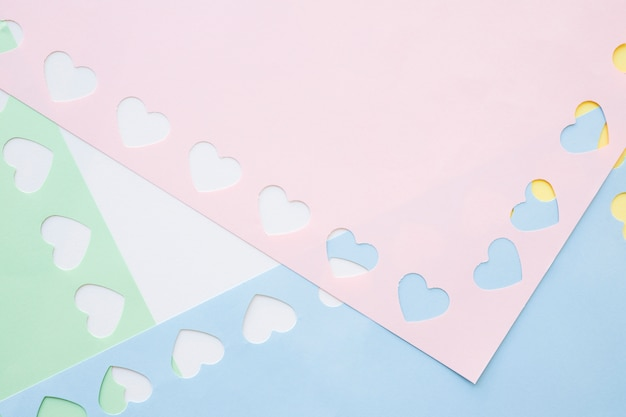 Small hearts on colorful paper