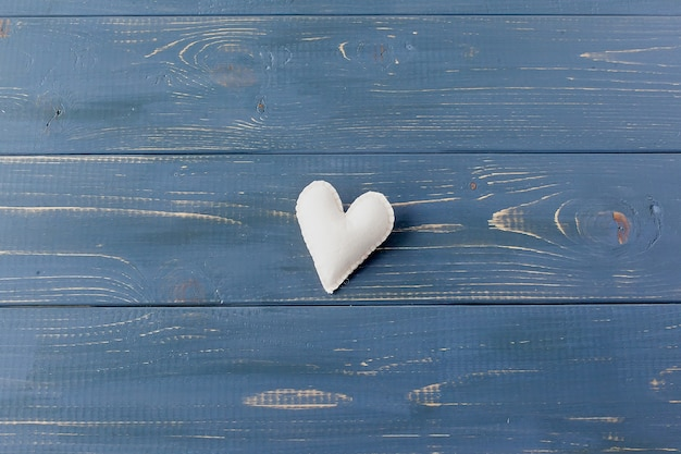 Small hearts on a textured background. a sign of love and happiness.