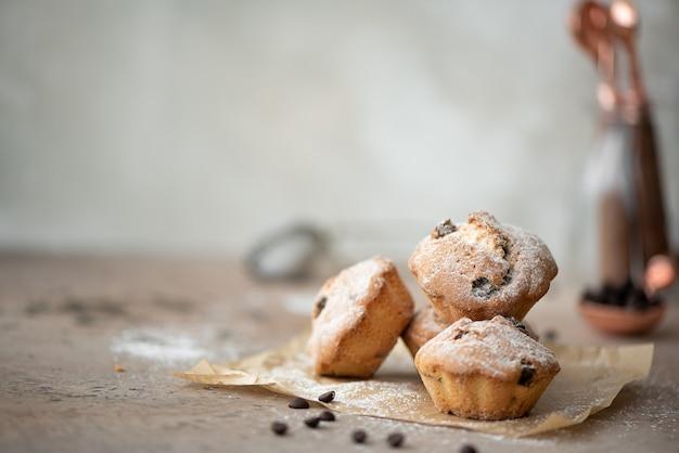 Small homemade muffins with cinnamon, chocolate and raisins