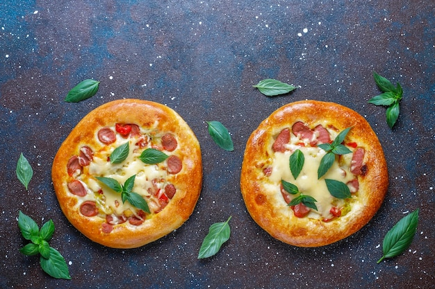Small homemade pizzas fresh with basil.