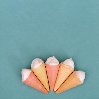 Small ice cream cones on green paper